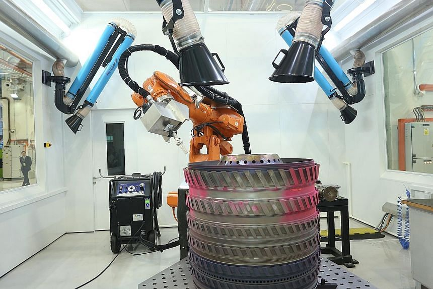 At the Advanced Remanufacturing and Technology Centre, aircraft parts are cleaned using dry ice-blasting.