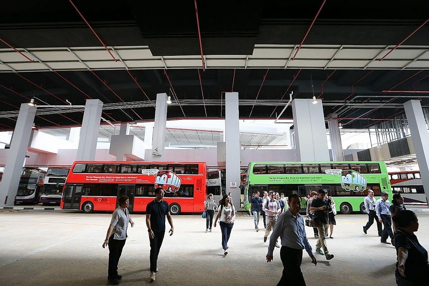 Buses painted in the proposed red and green for the fleet seen here at the Joo Koon Integrated Transport Hub.