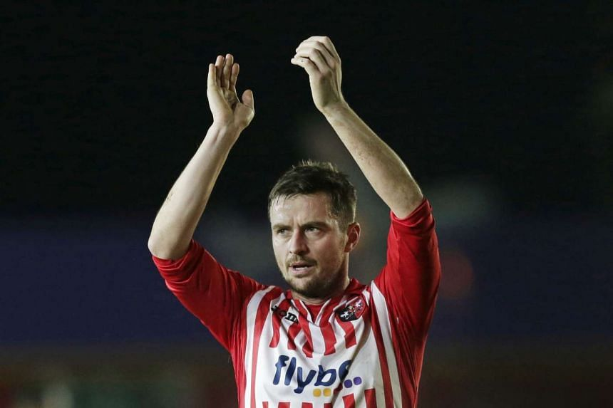 Exeter City's Matthew Oakley applauds the fans at the end of the game.