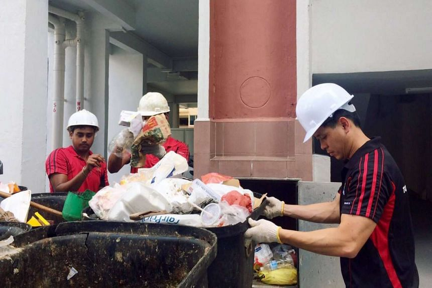 Nee Soon GRC MP Louis Ng (right) became a Town Council cleaner on Friday (Dec 8).