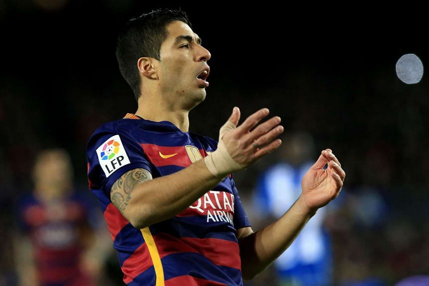 Barcelona's Uruguayan forward Luis Suarez reacts after missing a goal opportunity.