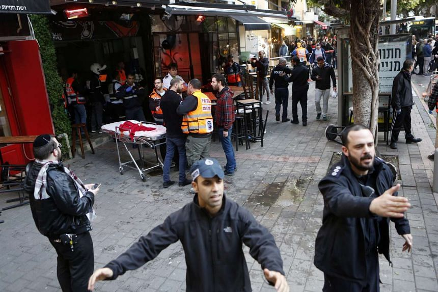 Israeli police clear the scene of the attack on Jan1, 2016.
