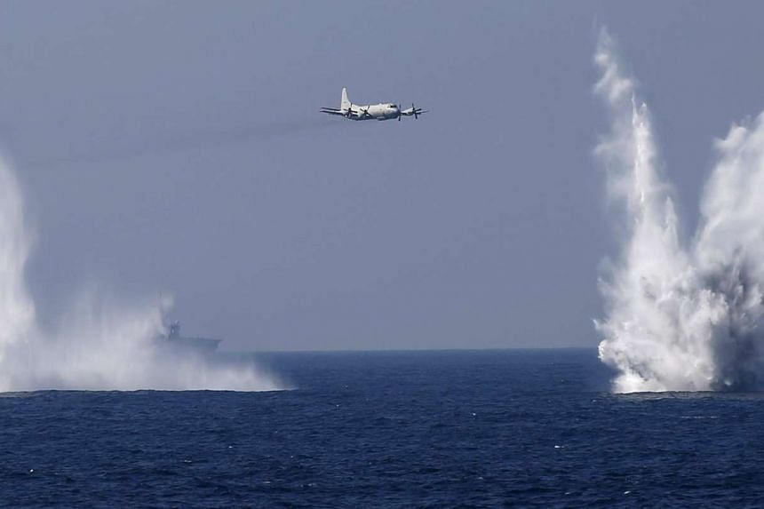 A Japan Maritime Self-Defense Force (JMSDF) P-3C aircraft dropping depth charges during a fleet review off Yokosuka on Oct 18, 2015.