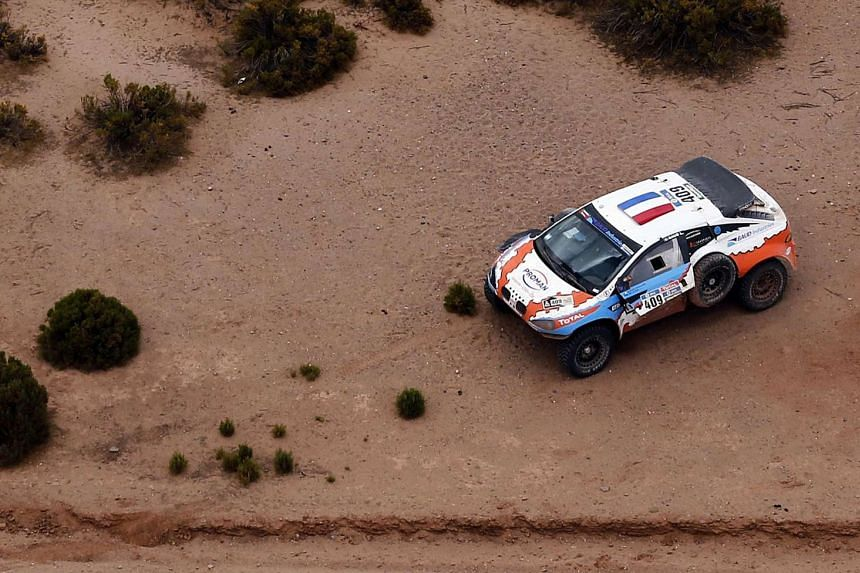 The Mitsubishi of Lionel Baud is seen on the side of the road during the Stage 7 of the Dakar Rally 2016.