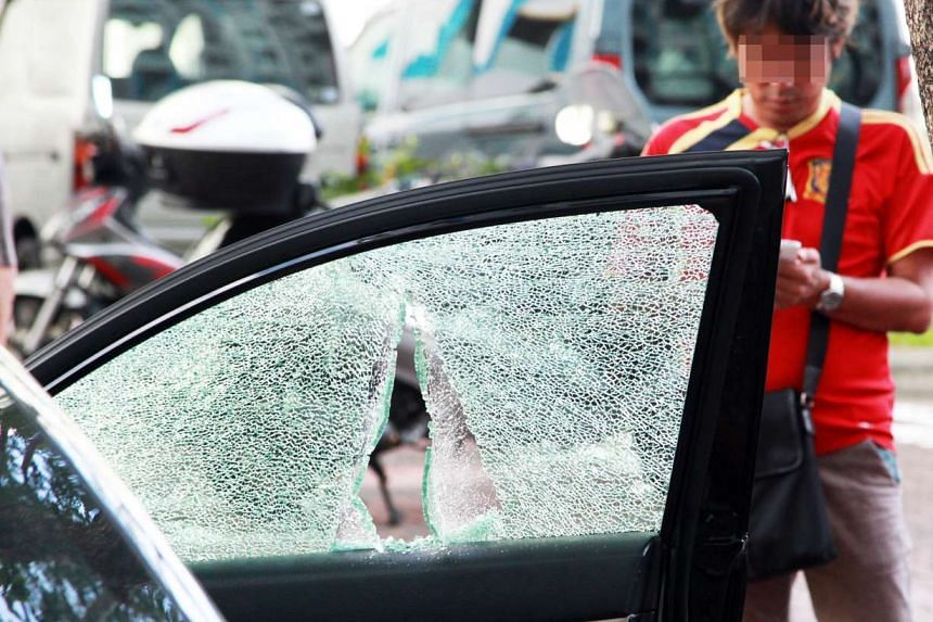 One of the cars that was hit by killer litter, showing the damage done to the window.