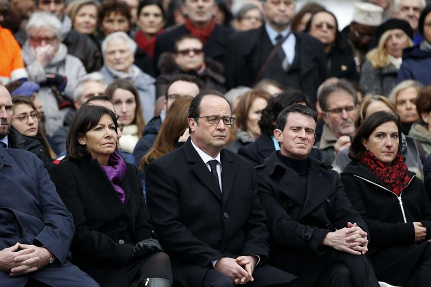 French President Francois Hollande (centre), Paris Mayor Anne Hidalgo (left), and Prime Minister Manuel Valls (second from right) attend a ceremony to pay tribute to the victims of the 2015 terror attacks.