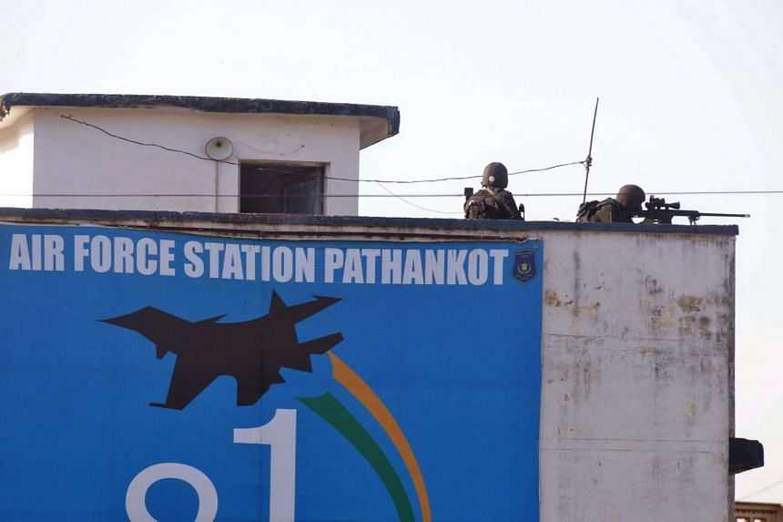 Indian commandos overlook the air force base in Pathankot on Jan 5, 2016.