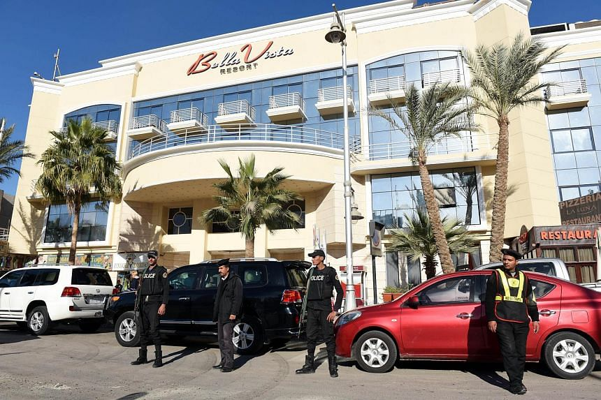 Egyptian police and security stand in front of the Bella Vista Hotel in Hurghada, Egypt on Jan 9.