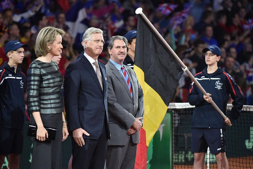 (From left) Queen Mathilde and King Philippe of Belgium and David Haggerty, president of the International Tennis Federation (ITF), stand on the court during the opening ceremony of the Davis Cup final between Belgium and Britain on Nov 27, 2015.