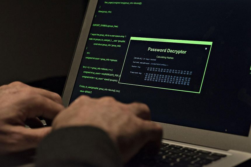 A man types on a laptop computer in an arranged photograph.