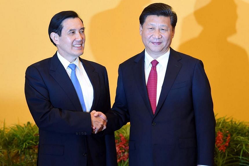 Chinese President Xi Jinping (right) shakes hands with Taiwan President Ma Ying-jeou before their meeting in Singapore on Nov 7, 2015.