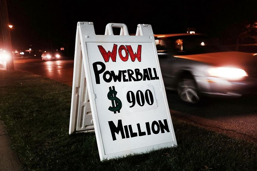 A sign outside of a Connecticut gas station displays the current winnings in the Powerball lottery.