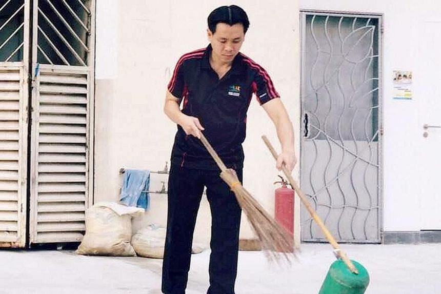 """Mr Ng, an MP for Nee Soon GRC, helping to clean up his ward last Friday. He called the work """"physically exhausting"""" and said small pieces of litter add up to a big pile of rubbish."""