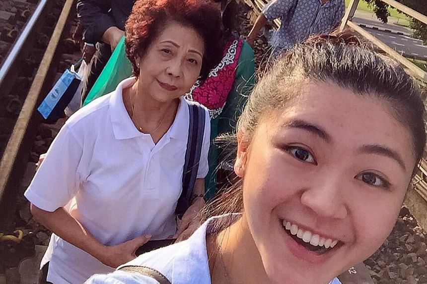 One train travelling in the direction of Marina South was stuck between Kranji and Marsiling stations yesterday. Commuters were forced to get off the train and walk towards Marsiling Station. Miss Chia (in front), who was one of them, took the MRT br