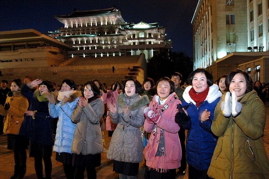 An army and civilian gathering in Pyongyang last Friday celebrating North Korea's first successful H-bomb test. Leader Kim Jong Un (above) has been called inexperienced and erratic but, with the test, he appears to have mastered a strategy that has s