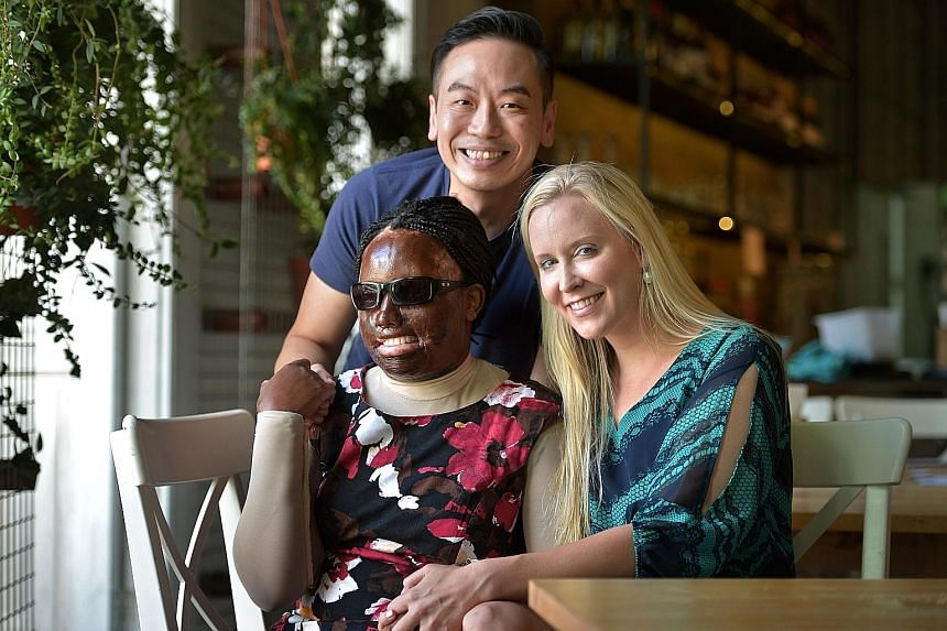 Ms Allen with celebrity chef Willin Low, who helped to raise funds for her trip to Singapore, and nurse Lynn Wood, who spent time with her every day. Ms Allen organised a party, with the help of nurse Lynn Wood (seated, second from left), to thank do