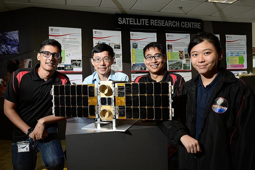 Research institutions here are geared up to tap into the opportunities offered by RIE2020. NTU, for example, has identified new areas of growth such as satellite development. Researchers are seen here with a model of a satellite recently launched int