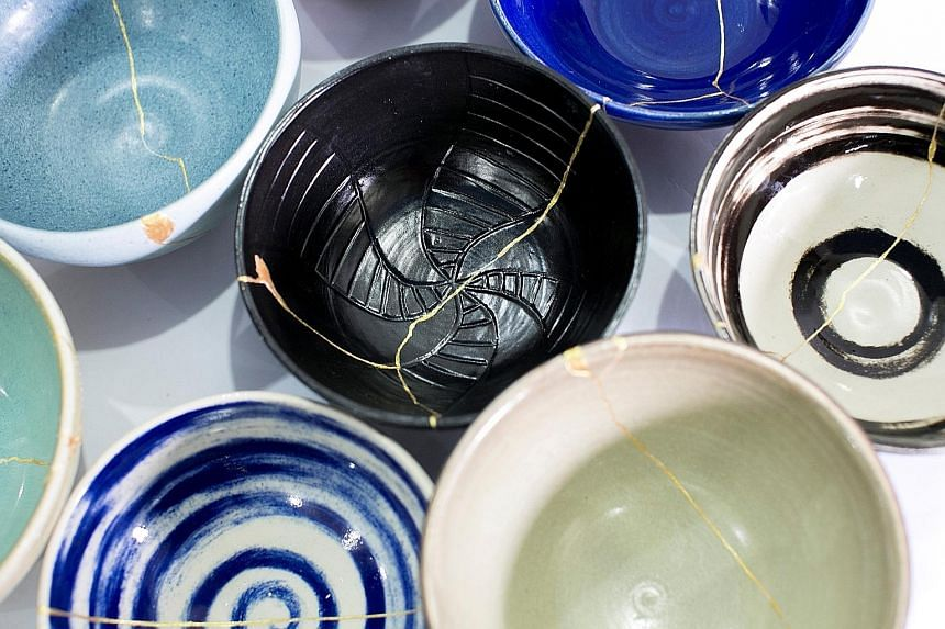 Former inmate and potter Kim Whye Kee (left) worked with 10 inmates to create a mixed-media installation called Family Dinner. One part of the piece features ceramic bowls which were smashed and mended back together (below).