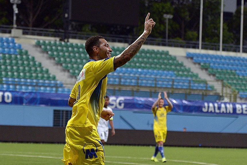 Top and above: Pennant celebrating Tampines' second goal, which was scored by Shakir Hamzah, last night. Moments earlier, the Englishman had provided the looping cross for Shakir to score. Right: The former Arsenal and Liverpool winger proved a hit w
