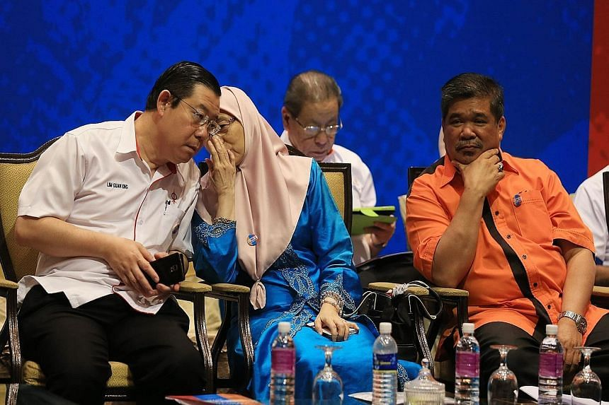 Pakatan Harapan leaders (front row from left) Lim Guan Eng, Wan Azizah Ismail, who is PKR president, and Mohamad Sabu, and DAP adviser Lim Kit Siang (back row) at the coalition's first leadership meeting yesterday.