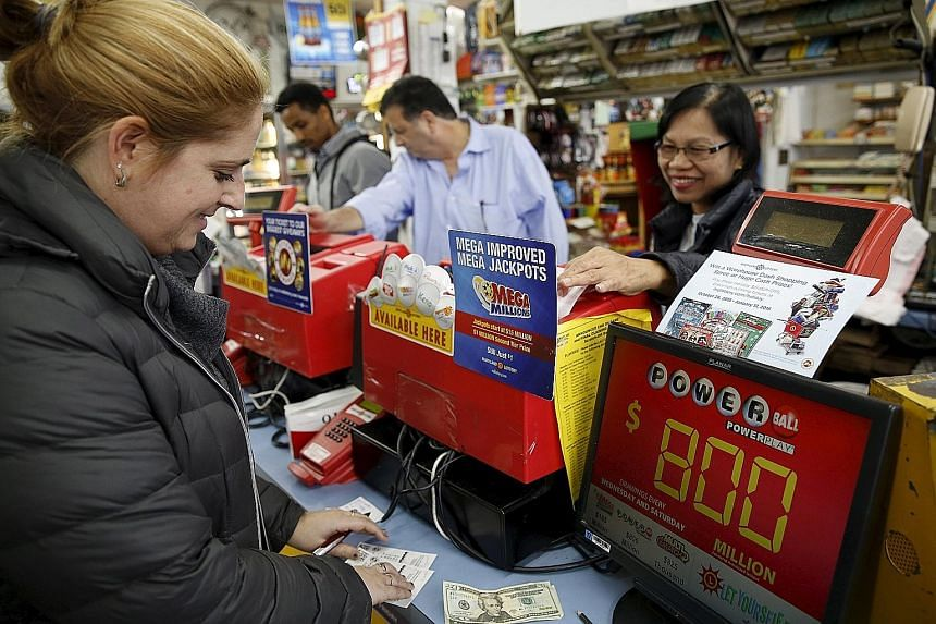 A customer buying Powerball lottery tickets in Bethesda, Maryland on Friday. The prize, which is currently worth US$800 million, is the largest in United States lottery history.