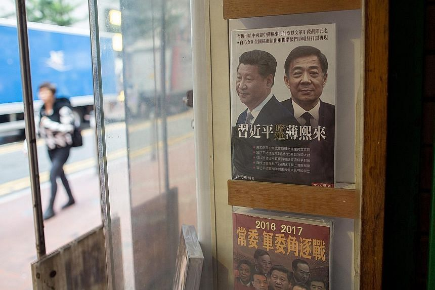 A book cover showing Chinese President Xi Jinping and former secretary of the Communist Party's Chongqing branch Bo Xilai is displayed in a window of the Causeway Bay Books.