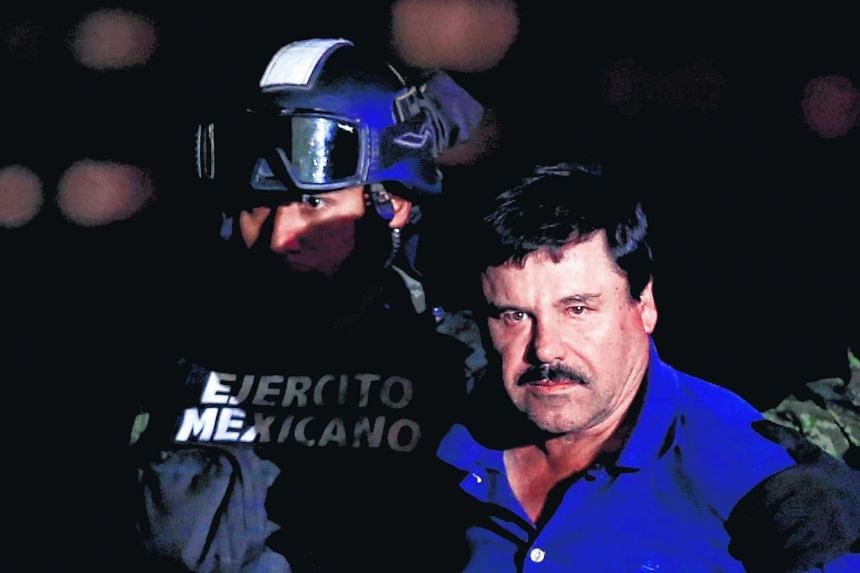 "Joaquin ""El Chapo"" Guzman is escorted by soldiers after recapture."