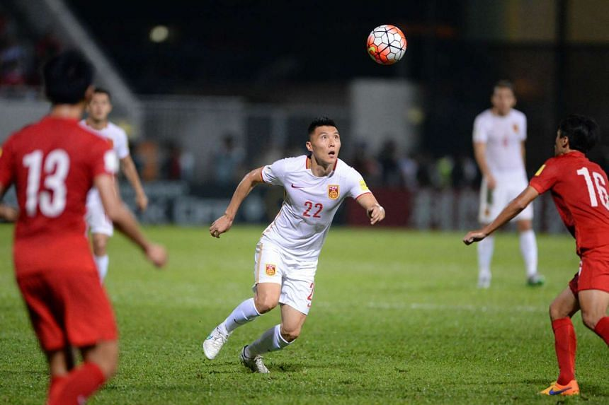 China's Yu Dabao (in white) in action during the World Cup qualifying match against Hong Kong on Nov 17, 2015.
