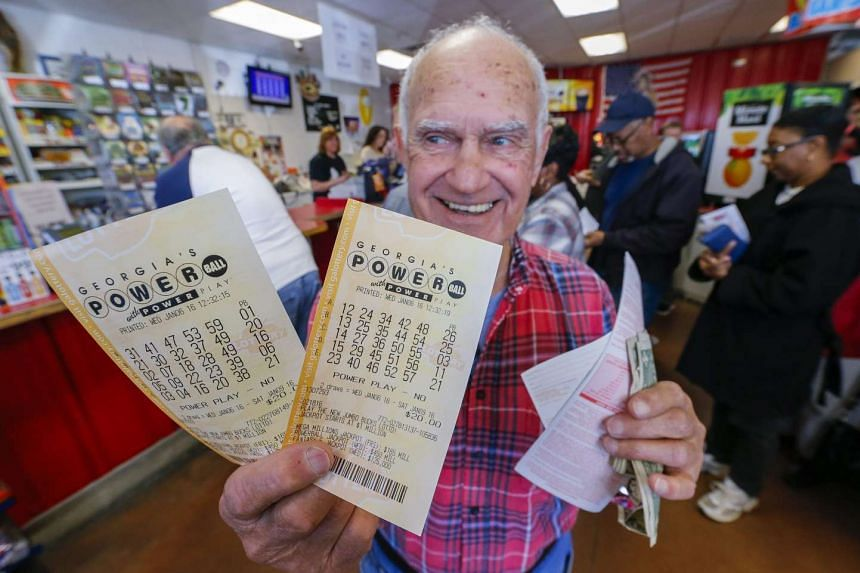 Pete Gagliano of Alabama shows the tickets he purchased for the multi-state Powerball lottery.