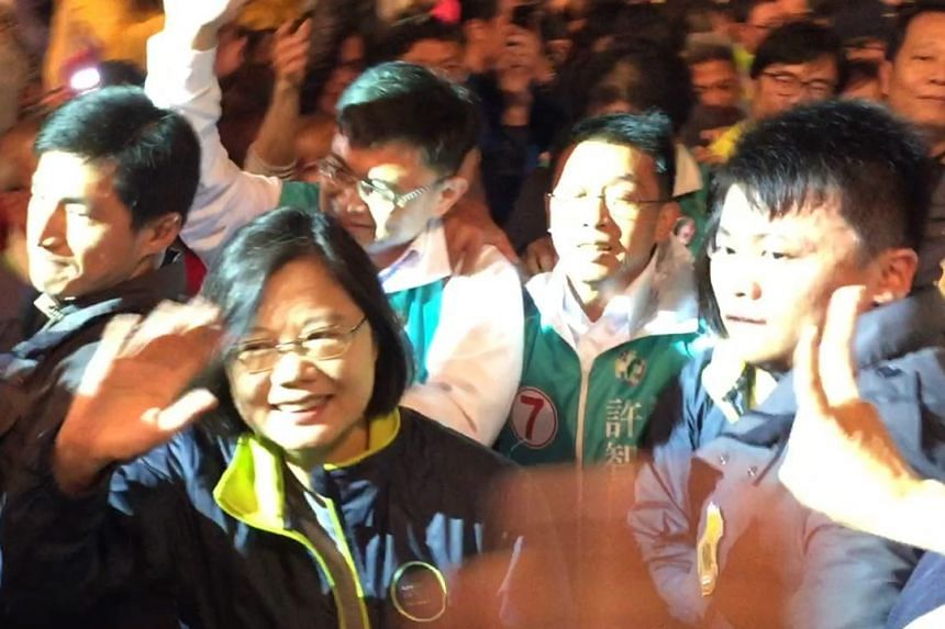 Taiwan's main opposition DPP's Tsai Ing-wen (front left) attends a party rally in Kaohsiung on Jan 9, 2015.