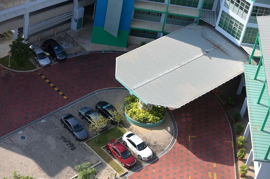 Cars parked in the Farrer Park Primary School compound.
