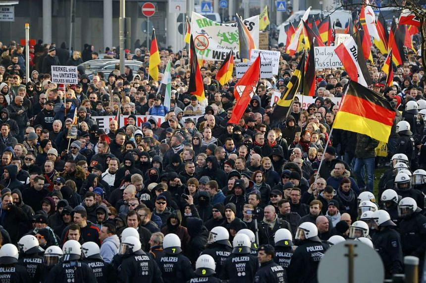 Pegida protesters take part in a demonstration march in Cologne, Germany.