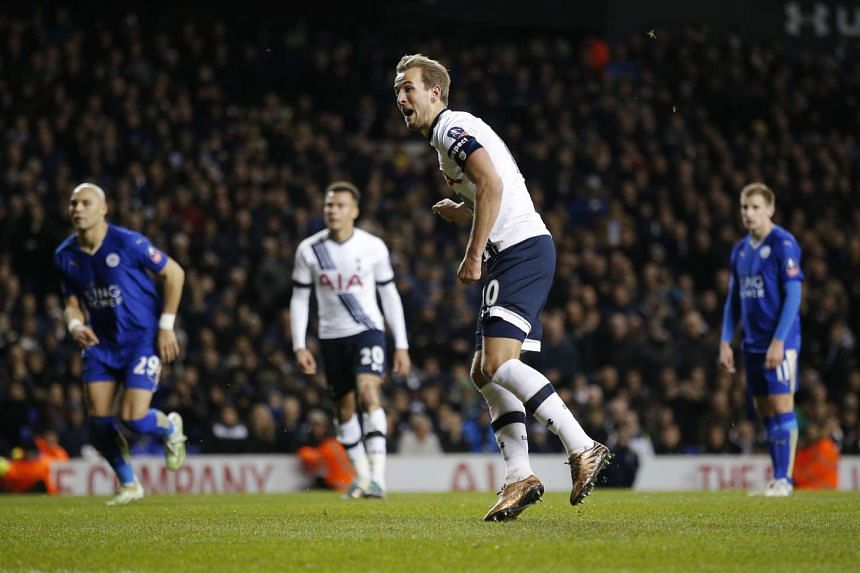 Tottenham forward Harry Kane (centre) celebrating after scoring from the penalty spot against Leicester during their FA Cup match on Jan 10, 2016.