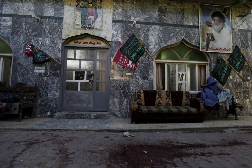 Blood stains are seen at a Shi'ite mosque after a suicide bomb attack in Baghdad on Dec 9, 2015.