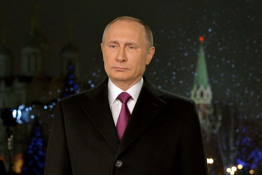Russian President Vladimir Putin delivers his New Year address in Moscow.