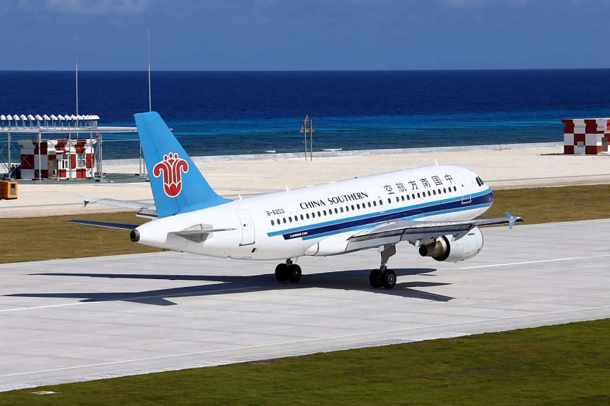 A China Southern Airlines plane lands at a newly built airport on Yongshu Reef, also known as Fiery Cross Reef, on Jan 6, 2016.