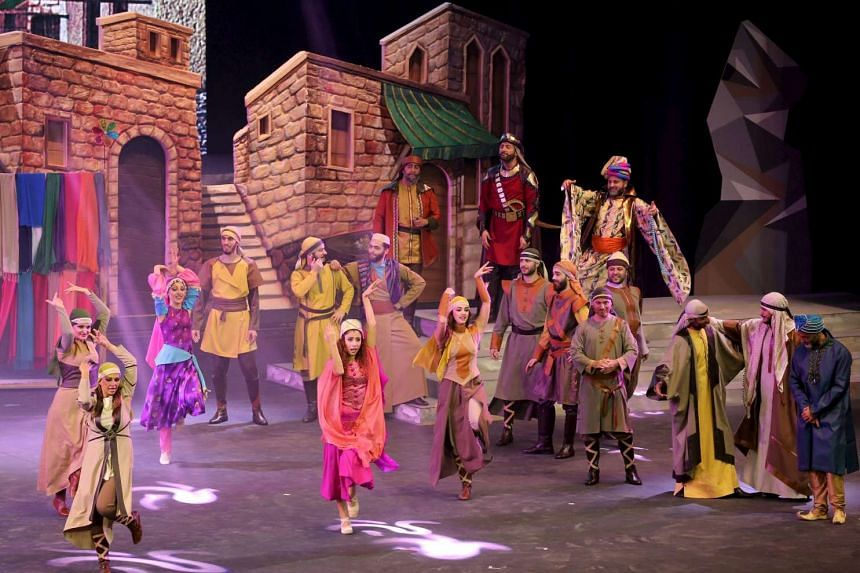 """Cast members act in """"Al Faris"""" or """"The Knight"""", a musical set to poetry penned by Dubai's monarch Sheikh Mohammed bin Rashid al-Maktoum, during its premiere in Dubai on Jan 6, 2016."""