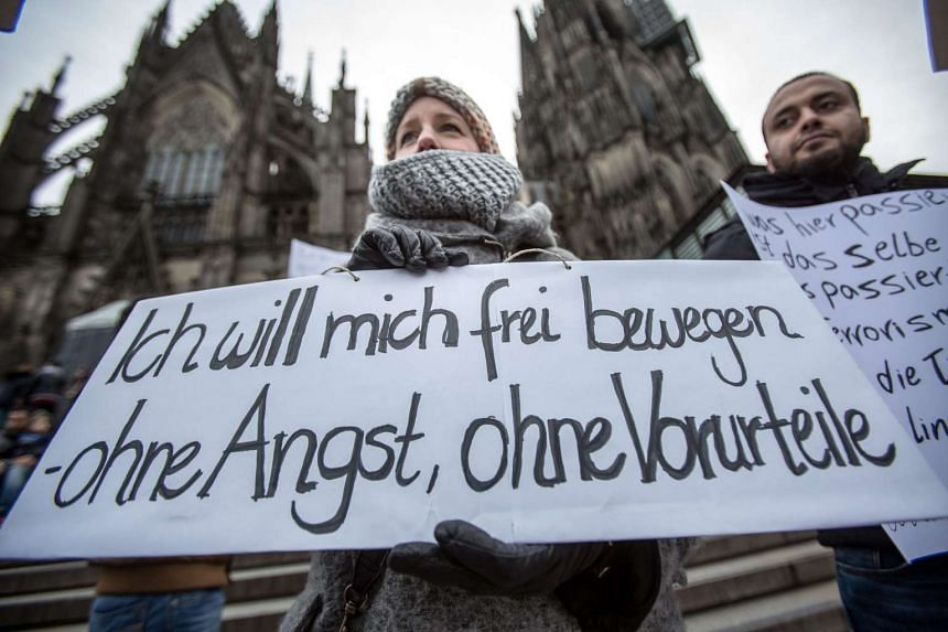 A woman protests against sexual violence in front of the central railway station in Cologne on Jan 10, 2016.