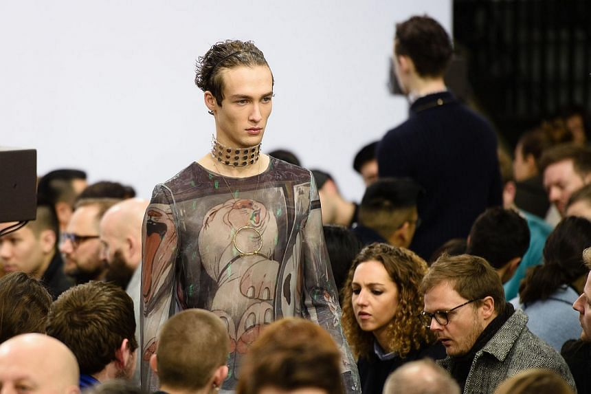A model presents creation from the J.W. Anderson collection on the third day of the Autumn/Winter 2016 London Collections: Men fashion event in London on Jan 10, 2016.