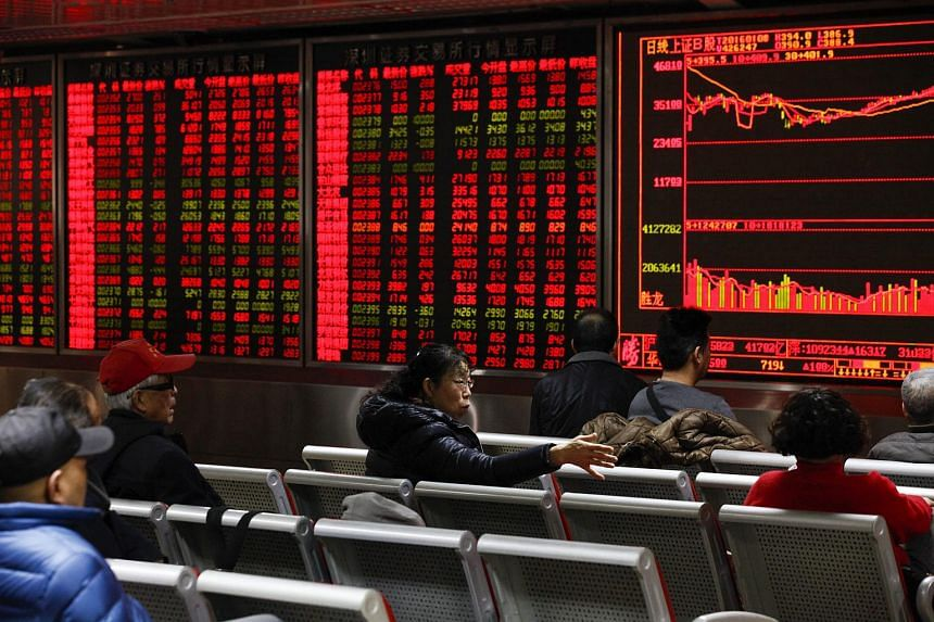 An electronic board displays stock market data at a securities brokerage house in Beijing on Jan 8.