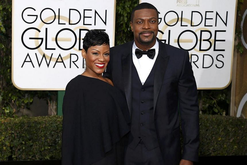 Actor Chris Tucker (right) and a guest arriving at the 73rd annual Golden Globe Awards.