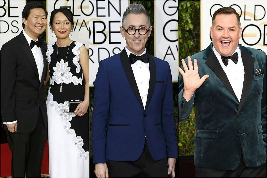 (From left) Actor Ken Jeong and his wife, Tran Jeong, actor Alan Cumming, and TV personality Ross Mathews arriving at the Golden Globe Awards.