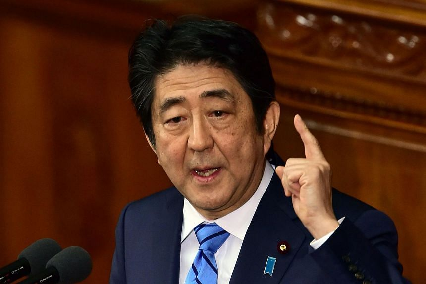 Japanese Prime Minister Shinzo Abe delivers a speech at the Lower House's plenary session on Jan 6.