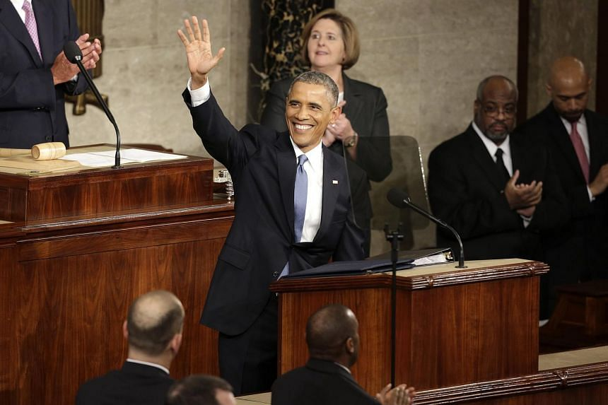 US President Barack Obama waves at the start of his State of the Union address in this Jan 20, 2015 file photograph.