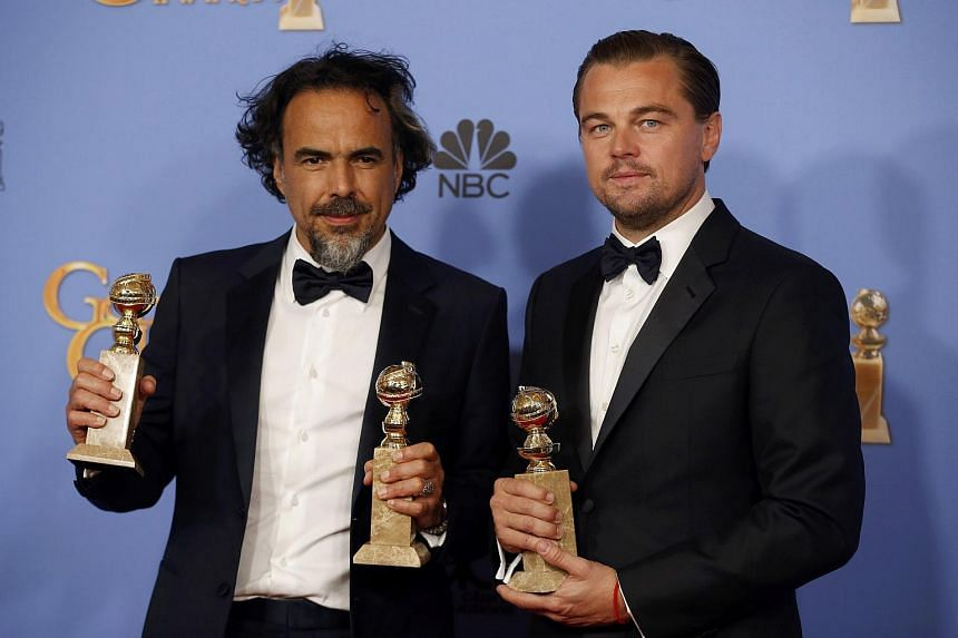 Alejandro Gonzalez Inarritu and  Leonardo DiCaprio poses with their awards for Best Director, Best Motion Picture and Best Performance by an Actor in a Motion Picture - Drama for The Revenant.