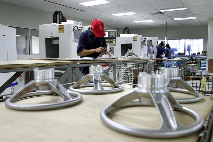 A worker seen on a production line at the Scomi Factory in Shah Alam, Kuala Lumpur, Malaysia.