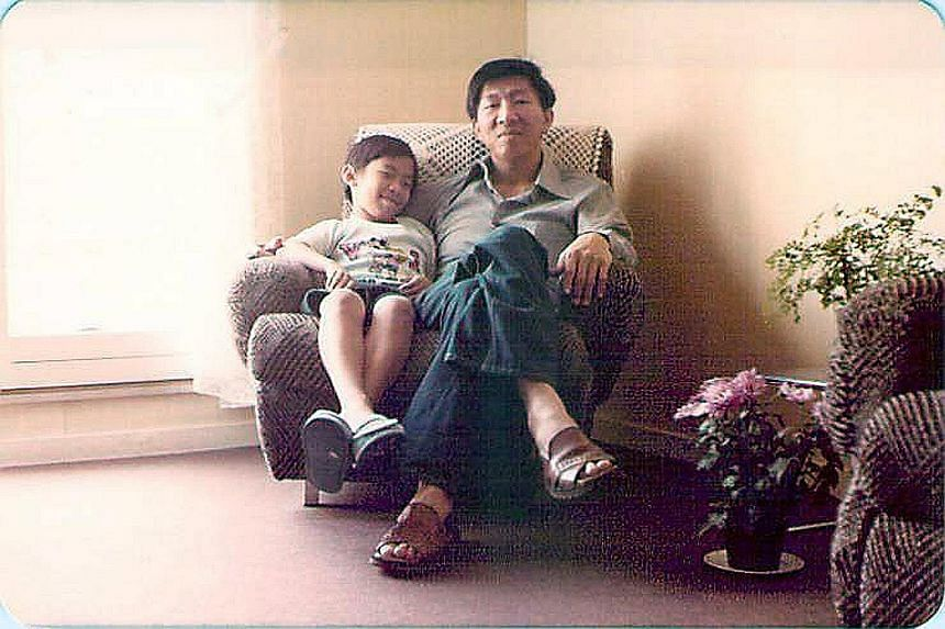 A 10-year-old Oon Wee Han with his father in their Paris apartment in 1984, when Steven Oon was a secretary in the Singapore Embassy.