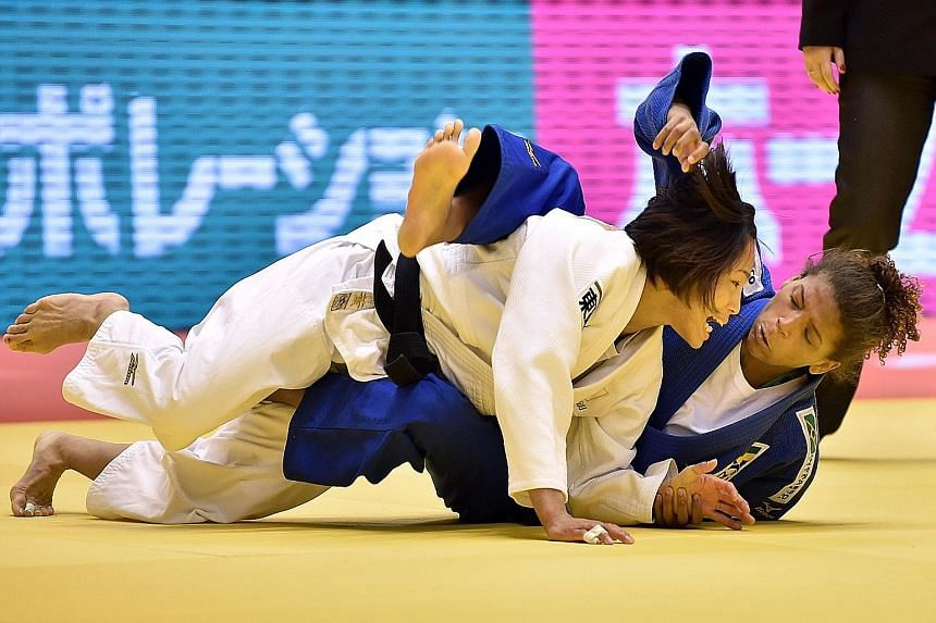 Rafaela Silva tackling Japan's Olympic and double world champion Kaori Matsumoto in the second round of the Grand Slam Tokyo last month. Both did not win a medal.
