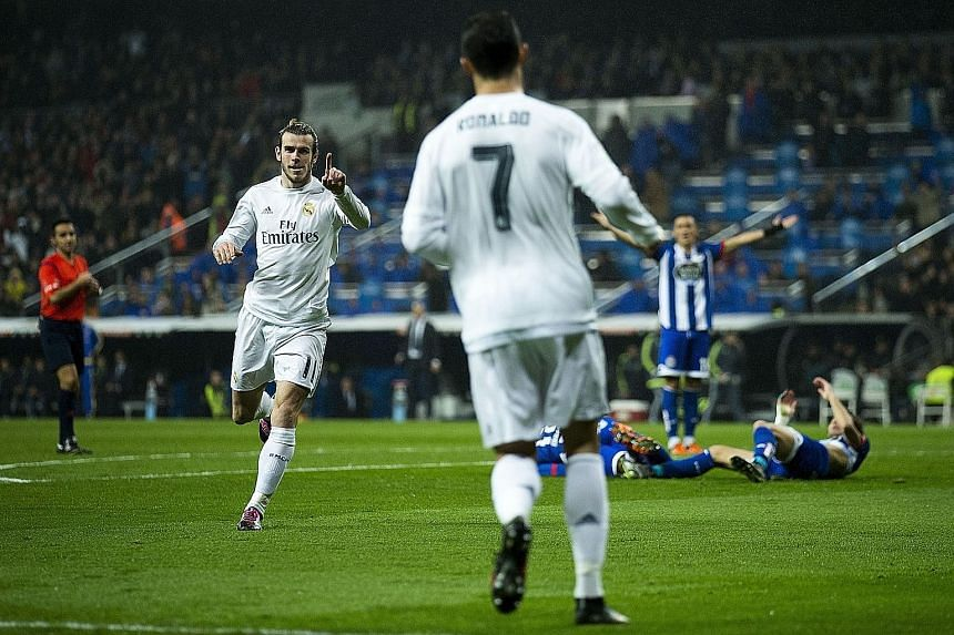 Real Madrid's Gareth Bale (above) celebrating one of his goals with Cristiano Ronaldo during their match against Deportivo at the Santiago Bernabeu stadium. Bale, who scored a hat-trick in their 5-0 win, says he has no doubt that France legend Zidane