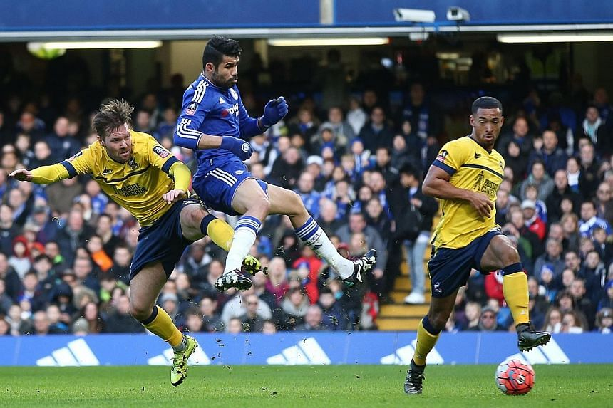 Despite the close attention of Scunthorpe defenders, Diego Costa (centre) was still able to find a way to score Chelsea's opening goal in their FA Cup third-round tie.